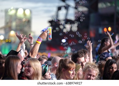 FERROPOLIS, GERMANY - JULY 15, 2016: Concert crowd with a bubble gun at MELT Festival on July 15, 2016 in Ferropolis.