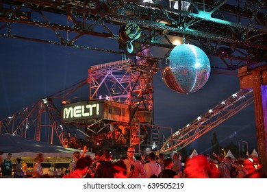 FERROPOLIS, GERMANY - JULY 17, 2016: The giant Melt Festival mirror ball with huge excavation machinery backdrop on July 17, 2016 in Ferropolis.