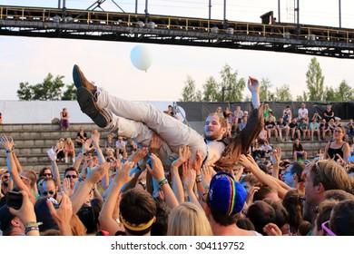 FERROPOLIS, GERMANY - JULY 18, 2015: Michael Marco Fizthum  of alternative pop/rock band WANDA crowd surfing at MELT Festival on July 18, 2015 in Ferropolis.