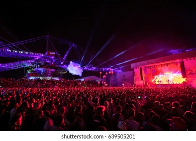 FERROPOLIS, GERMANY - JULY 18, 2016: Disclosure, an English electronic music duo, playing  in front of a large crowd drenched in red light at MELT Festival on July 18, 2016 in Ferropolis.