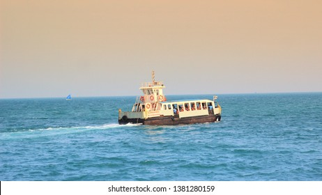 A ferry boat carrying visitors to Vivekananda Rock, Kanyakumari from the sea shore. Tamil Nadu, India:  Dec 2018
