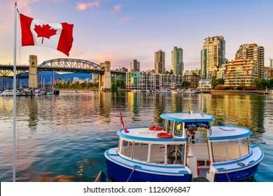 Ferry boat docked along in Granville island near Burrard Street Bridge at twilight in Vancouver,Canada