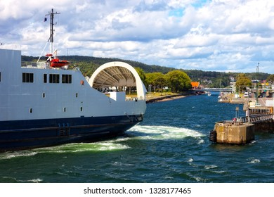 Ferry boat with its door open maneuvers in the port of Moss, Norway.