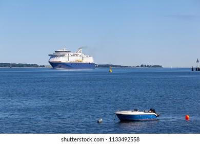 Ferry and boat on the Baltic Sea near Kiel, Germany