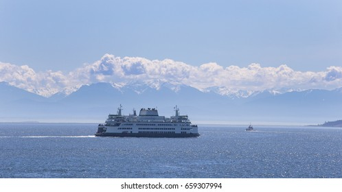 Ferry boat on the way with snow mountain background