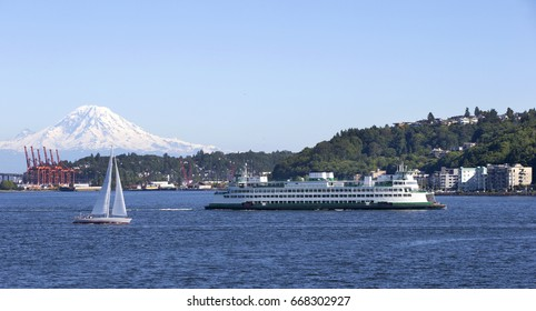 Ferry boat on the way with snow covered Mt Rainier in the background