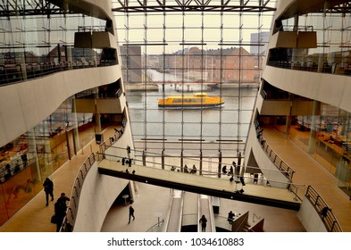 Ferry boat passing outside the Black Diamond Library in the centre of Copenhagen. Denmark. Europe. February 2018