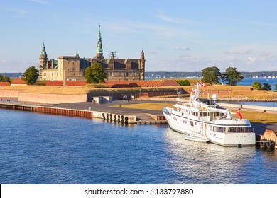 Ferry boat at pier, Kronborg castle at backgroung, Danmark, Europe
