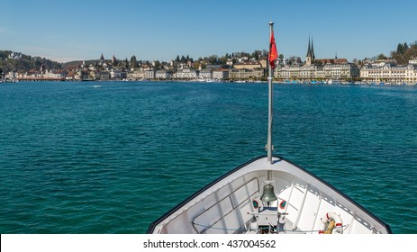 Ferry boat with red swiss flag on Lake Lucerne (Vierwaldstattersee) Switzerland. Motor Cruise Ship Waldstatter sail from Weggis under clear blue sky sunny day in summer with Lucerne skyline cityscape