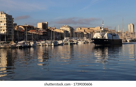 Ferry boat with tourists in the old port of Marseille, France