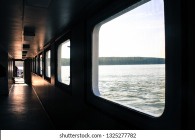 Ferry corridor, square windows, light falls on the floor. Transit from Klaipeda to the Curonian Spit