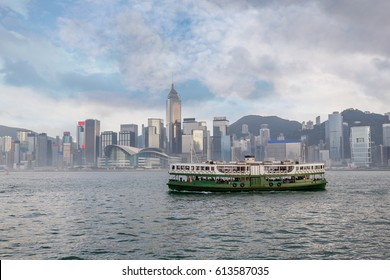 A Ferry crossing Victoria Harbor from Tsim Sha Tsui with downtown Hong Kong's financial district skyline in the background.