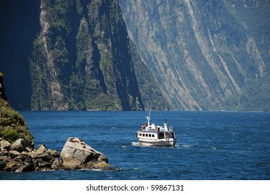 A ferry cruising in Milford sound
