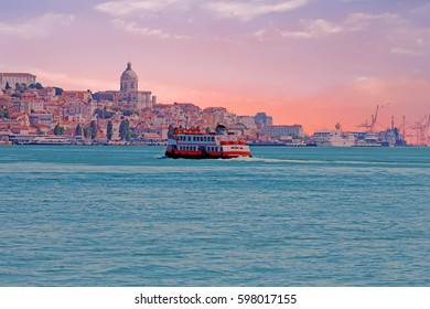 Ferry cruising on the river Tejo near Lisbon Portugal at sunset