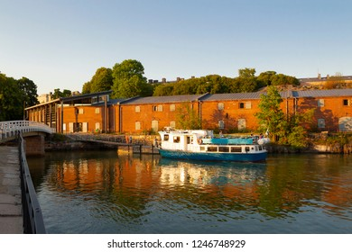 A ferry docked at the pier on Suomenlinna Island in the Gulf of Finland in Finland on a sunny summer day.