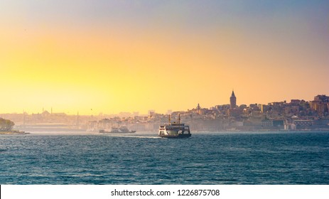 Ferry floats on the way to Bosphorus with Sultan Ahmet Mosque on the background of Istanbul at sunset.