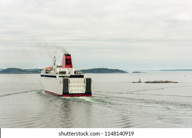 Ferry is leaving the port between islands in the Baltic Sea, Sweden.