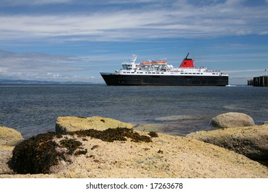 A ferry leaving port off a Scottish island