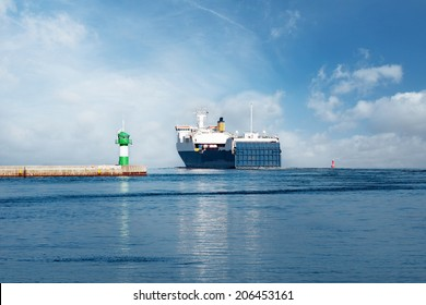 Ferry on the Baltic Sea with green Lighthouse