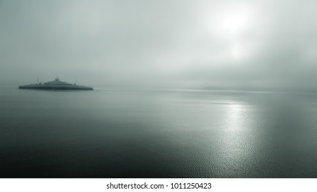 Ferry on fjord in foggy weather in southern Norway