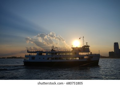 ferry on the sea with sunset , New York City