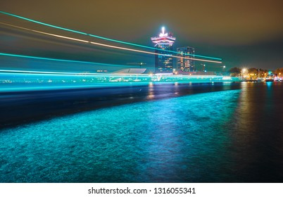 Ferry on the water in motion at night in Amsterdam.