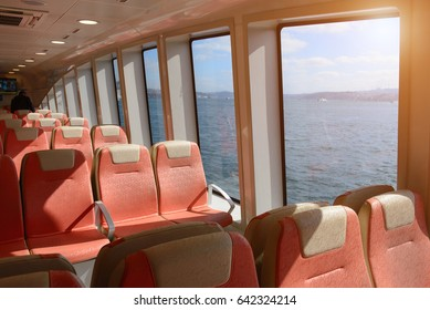 Ferry over Bosporus in Istanbul, Turkey. Interior of a ship with empty passengers seats and sea view.