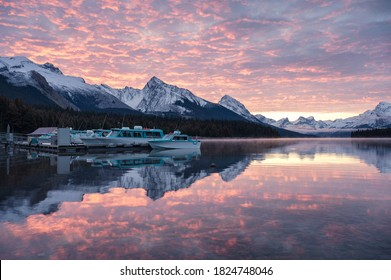 Ferry pier and colorful altocumulus clouds on Maligne Lake at Jasper national park, Canada