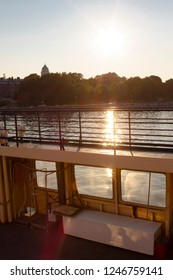 Ferry railing and sunset view near Suomenlinna Island in the Gulf of Finland on a beautiful summer evening. The concept of transportation by ferry in the Gulf of Finland.