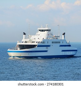 Ferry sailing in the bright sunny day