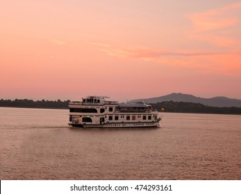 Ferry sailing over river Brahmaputra during sunset