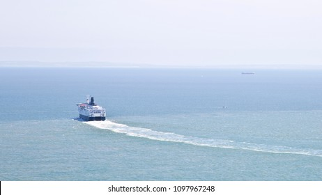 Ferry ship sailing away on the Ocean