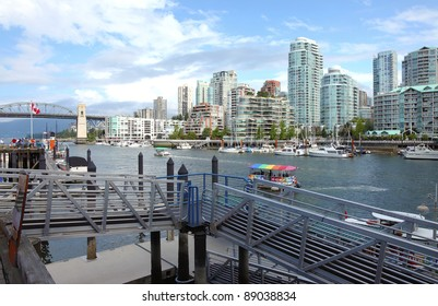 Ferry terminal in Granville island in Vancouver BC., Canada aqua-buses & the skyline across False creek.