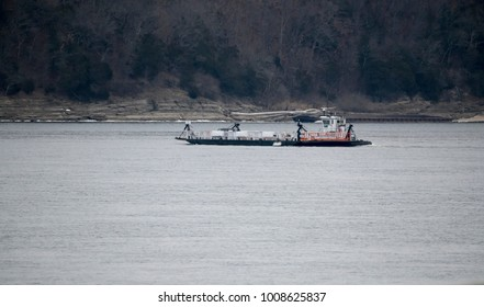 Ferry transports SUV across river