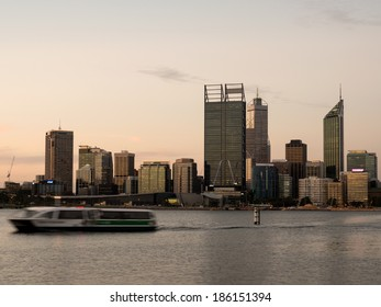 Ferry traveling on the Swan River with the Perth city skyline in the background