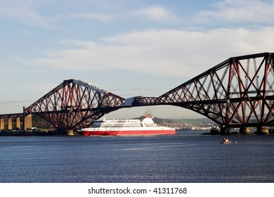Ferry under the Forth Rail Bridge at South Queensferry Scotland