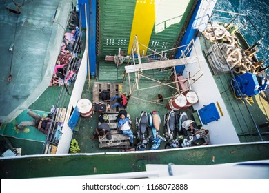 Ferry from Wakai to Gorontalo, Sulawesi, Indonesia - July 21 2015: Locals and carriage on the ferry