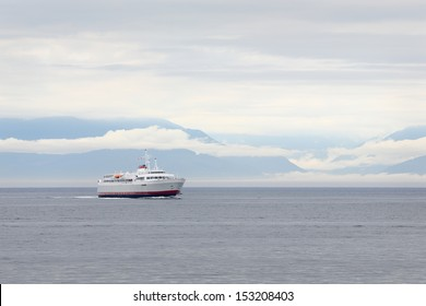 Ferry, Washington State, Olympic Peninsula. The ferry, Carrying passengers and vehicles, from Port Angeles in Washington State to Victoria's Inner Harbor. British Columbia, Canada.