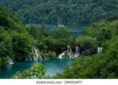 Ferry and waterfalls at Plitvice Lakes National Park