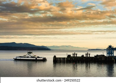 """Ferryboat Docking. A ferryboat takes passengers to Lummi Island, Washington in the San Juan Islands of Puget Sound. The """"Whatcom Chief"""" has been serving the island for 50 years."""