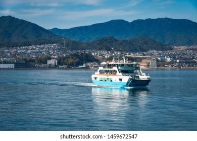 Ferry-boat to the island of Miyajima - Hiroshima Bay, Japan. Miyajima Island is a Holi Shinto Shrine, listed as an Unesco World Heritage Site.