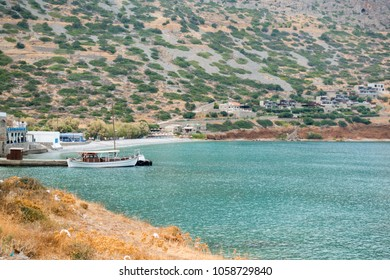 Ferryboat moored at harbor in Spinalonga, Crete, Greece