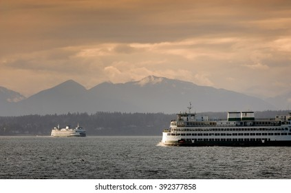 Ferryboats and Mountains. A view from Alki Beach in West Seatte of ferryboats and the Olympic Mountains during a lovely warm springtime sunset.