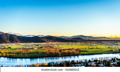 The fertile farmland of the Fraser Valley in British Columbia south of the Fraser River with Mount Baker in the distant background. Viewed from Mission Hill, north of the Fraser River