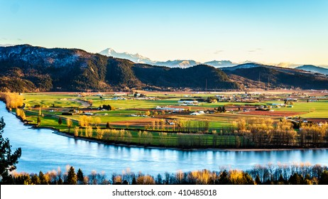 The fertile farmland of the Fraser Valley in British Columbia south of the Fraser River with Mount Baker in the distant background behind Sumas Mountain from Mission Hill, north of the Fraser River