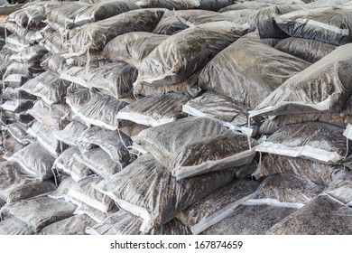 fertilizer in plastic bags stacked layers.
