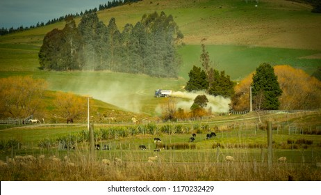 a fertilizer truck spreads lime on a farmers paddock in spring