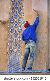 FES - FEBRUARY 09: Unidentified Moroccan man make waterproof plaster Tadelakt, originally fashioned from lime specific to the Marrakech region of Morocco. February 09, 2009 in Fes, Morocco.