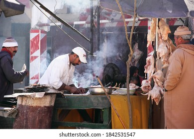 FES, MOROCCO - FEB 09: Unidentified morrocan man cook chiken on the city market on February 09, 2020 in outskirts of Fez, Morocco, Maghreb, North West Africa
