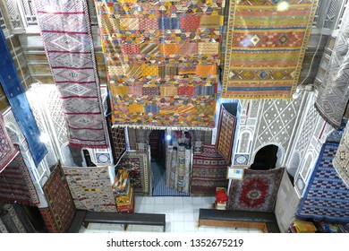 FES, MOROCCO - FEB 13, 2019 - Carpets hanging over atrium of shop in the medina of Fes, Morocco, Africa